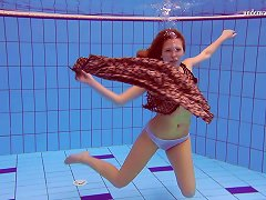 Free Porn Slim Redhead Looker Dives Around The Pool In The Nude