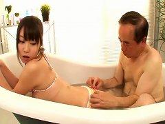 Free Porn Bikini-clad Asian Teen With Huge Tits Sucking An Old Man's Cock