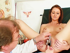 Free Porn Speculum Peers Inside A Young Vagina