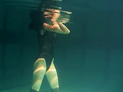 Free Porn Slim Raven-haired Cutie Undresses While Diving Inside Of A Pool