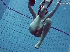 Free Porn Slender Raven-haired Stunner Undresses While Diving In The Pool