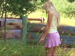 Free Porn Long Haired Blonde Cutie Enjoys Fingering Her Bald Snatch Outdoors